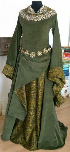 Over mantle is pulled important and draped to the side to show lovely contrast patterned lining [Renaissance Festival, but too hot to wear...  Lady--Eowyn deviantart]