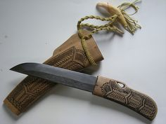 """Wood Craft.  ainu knife.  makiri.  made by Mr.Tahachi Urakawa.   The design of the knife handle and the sheath is transmitted to the Urakawa family.   The strap is bear's fang.   The blade is a work of blacksmith nickname """"bear"""" of the Saitama Prefecture l"""