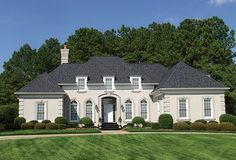 A single level French Country design features the grace and charm of a country manor in a 2500 sq. footprint.