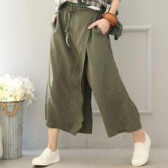 商品编号:10015016014 材料:亚麻布 特点:不规则的设计 休闲宽松的风格 均码适合S / M / L 腰围:66-88厘米(可拉伸) 裤子长度:78厘米 臀围:118厘米 大腿:78厘米