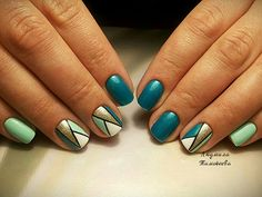 The Glittered Geometric Nail Art. The glittered gold, when combined with the aqua shades, gives us the most amazing geometric nail art.