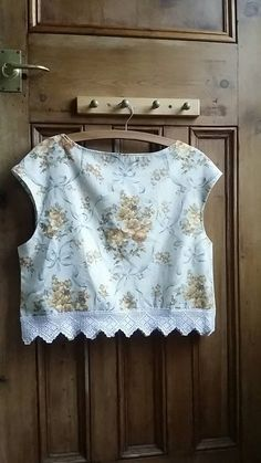 Hand made ladies blouse made from vintage fabric and hand crochet lace edging . Cream with yellow roses and pale blue bows. Measurements UK