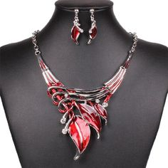 Qiyun (TM) Girl's Funky Hot Red Enamel Leaf Silver Chain Art Deco Necklace Earrings Set Qiyun http://www.amazon.com/dp/B00KA3VXYO/ref=cm_sw_r_pi_dp_fw8Dvb0X7Q0BY