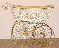 antique baby carriage | ... usual white ones, plus it has a fancy umbrella to shade baby's face