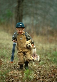 This is one of the cutest things I've ever seen!! Nothing like a boy and his dog (and his shotgun)! :)