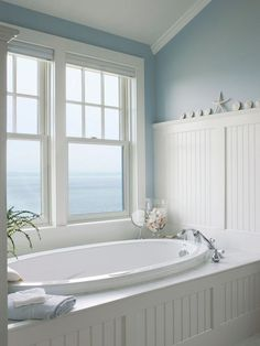 Cottage Master Bathroom with Drop-In Bathtub, Beadboard, Wainscoting, Master bathroom, Crown molding, High ceiling
