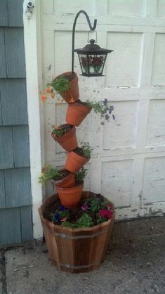 My version of terracotta planter. Use a shepherd hook for rod and then hung a s. - Garten - My version of terracotta planter. Use a shepherd hook for rod and then hung a solar light from hoo - Garden Yard Ideas, Diy Garden Projects, Garden Crafts, Garden Planters, Rocks Garden, Spring Garden, Winter Garden, Backyard Landscaping, Container Gardening
