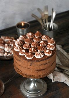 Gingerbread cake with dark chocolate frosting and meringues