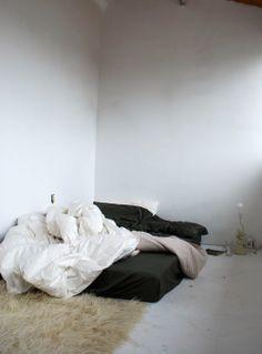 black sheets, white rug