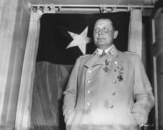 Hermann Göring in captivity May 9, 1945. Note the Texas state flag as background. He was allowed to wear his medals for the purpose of being photographed.