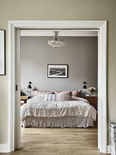 inspiring bedroom with pink linen textiles and lovely art.