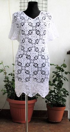 Lovely elegant crochet lace dress in color white. Perfect for various occasions. 100% handmade by me. Without lining.   Material: soft cotton yarn with acrylic   Bust: 98 cm = 38.6 in up to 104 cm = 40.9 in Hips: 102 cm = 40.2 in up to 105 cm = 41.3 in Lenght of dress from arm : 99 cm = 39 in Length of sleeve: 39 cm = 15.4 in  Please, feel free to contact me for further information. Thank you very much for your interest :)