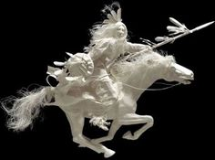 this is a paper casting- made in a mold.  amazing how they have captured so much movement with paper...