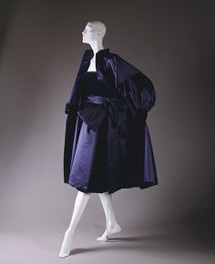 "Christian Dior, 1949. ""Pisanelle"" cocktail ensemble made of navy and blue silk satin with navy silk velvet. Worn by Thelma Foy."