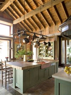 kitchen with green cabinets and hanging pots. Green Kitchen, Kitchen Colors, New Kitchen, Kitchen White, Cabin Kitchens, Cool Kitchens, Kitchen Interior, Kitchen Decor, Kitchen Rustic
