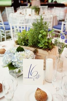 Like these herbal centerpieces that are wooden- should be shorter though so you can see over them.