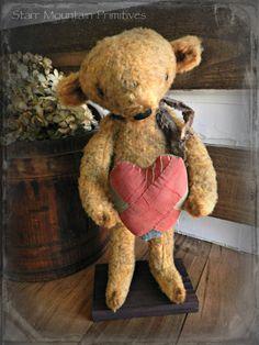 Primitive Standing Bear holding 1800's quilt scrap heart. https://www.facebook.com/pages/Starr-Mountain-Primitives/228548684018