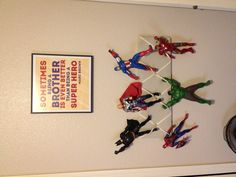 The boy's new super hero room! French bulletin board with super heroes hanging on!