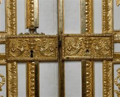 Detail of the locks on the doors The Apollo Drawing Room in the Palace of Versailles