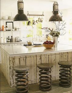 this is what I want to do on the half wall of my kitchen...old chippy paint wood.  also love the stools