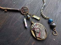 Stelliferous- Iridescent mixed media assemblage necklace- rustic artisan jewelry by fancifuldevices