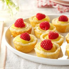 Mini Lemon Cheesecake Tarts Recipe -Dainty and light, these tartlets feature two of my favorites —lemon and cheesecake —in one yummy morsel. They look lovely topped with fresh raspberries, but sliced strawberries are just as pretty and delicious. —Gwyn Brandt, Hibbing, Minnesota