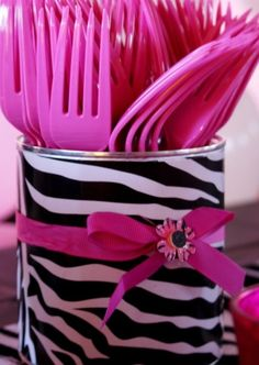 Cover a can for a utensil/sucker/favor/snack holder. Duct tape or wrapping paper.