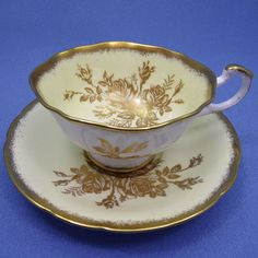 Paragon Tea Cup and Saucer Yellow and Gold Rose by Thinkilikeit