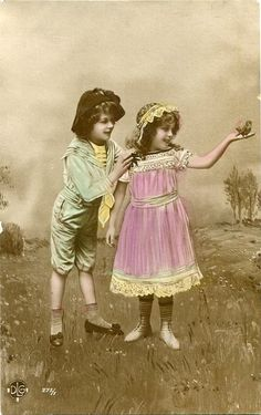 Original French vintage hand tinted real photo postcard - Boy and girl with bird…