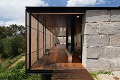 Archier Recycles 270 castaway concrete blocks to create modern cliffside home