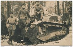 """French soldiers in the tank """"Renault FT-17"""" in the winter woods."""