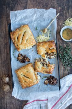 Recipe For Black Garlic, Mushroom & Cheddar Pasties With Salted Thyme Honey Drizzle - Kay's Kitchen Vegetarian Teas, Vegetarian Recipes, Garlic Mushrooms, Stuffed Mushrooms, Black Garlic, Cheesy Sauce, Garlic Recipes, Milk Recipes, Salted Butter