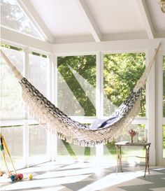 This is where I want to be!! Reminds me of my hammock growing up....exactly like this one in a porch corner!!