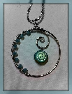Made this with a gorgeous heart bead hanging fro the center swirl.