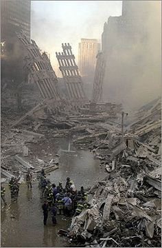 September 11, 2001   Emergency personnel gathered at the site of the fallen World Trade Center.