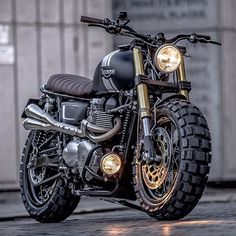 A bullet-ridden BMW from Sicily, a stunning Honda cafe racer from GT-Moto, and Ducati Scrambler tweaked an an Italian eyewear company. Moto Scrambler, Triumph Scrambler Custom, Triumph Cafe Racer, Custom Choppers, Cafe Racer Bikes, Moto Guzzi, Triumph Bonneville T100, Harley Davidson, Cool Motorcycles