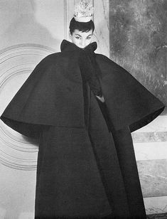 Lucky is wearing voluminous coat by Balenciaga, photo by Louise Dahl-Wolfe, 1953