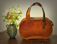 Oval - made entirely from pull-up and crazy horse leather in our studio.   For more info contact us on FB.