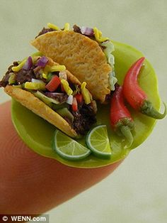 Note that this plate of tacos is resting on a finger tip! Made of polymer clay.