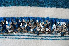Detail shot of a #Moroccan #striped #wool throw! It is so #cozy and #glamorous. 2 wide bands of hand sewn #sequins on either end add an incredibly glamorous touch.All hand woven. Perfect at the foot of twin beds, on the back of a couch or folded on the side of a chair. This is also a perfect wedding or hostess gift! A Maryam Montague original #design. Available at Maryam Montague's online #Souk! Ships #free to the #US, #Canada, & #Europe!