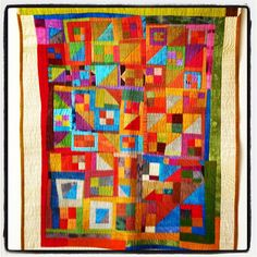 This was my youngest's crib quilt several years ago. We hung it today in her room