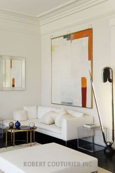 Robert Couturier House in Salzburg, Austria – Gallery | Robert Couturier | décor, architecture design | large oversized abstract white cream orange and red painting artwork in contemporary white living rom | modern residential interior design