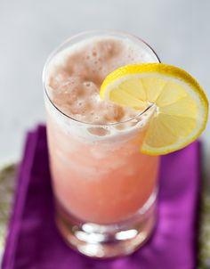 Chambord Gin Fizz. Gin, Chambord, lemon juice, simple syrup, egg white, club soda. Garnish with lemon wheel.