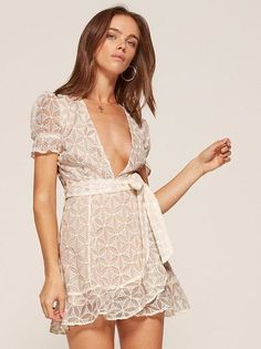 Ruffles, not like chips. This is a mini length, wrap dress with ruffle edged sleeves and a ruffled hem.