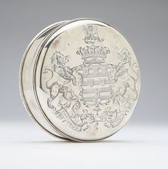 A George IV sterling silver seal box, 1824, Exeter, maker's mark of James Dunsford, circular, the domed cover engraved with the arms of the Earl of Exeter and the motto ?Cor Unum Via Una? (One Heart One Way), engraved to underside ''Brownlow Cecil / 12th / Earl of Exeter / Anno Domini 1825'' with a crossed keys and sword crest.