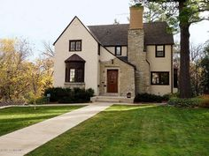 A lovely Tudor-style home in Rochester, MN. The brick doorway and chimney are so cute.