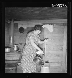 Cleaning butter churn. NC circa 1939