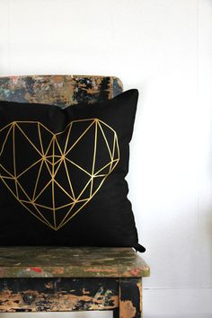 A pillow bedecked with a sparkly geometric <3