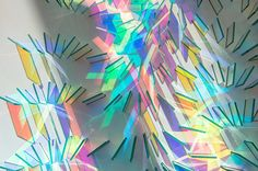 http://www.thisiscolossal.com/2017/02/new-geometric-dichroic-glass-installations-by-chris-wood/
