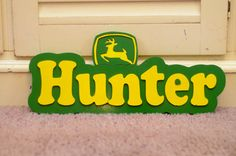 A personalized name plaque in John deere theme, other themes available upon request, 9 inches high and 20 inches long . personalize yours with any